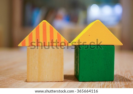 Wooden toy blocks in house shape - stock photo