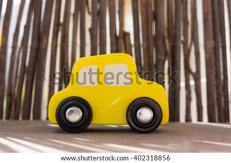 Wooden toy car on wooden shelf