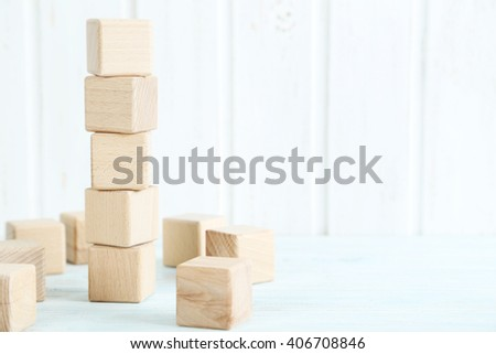 Wooden toy cubes on a blue wooden table - stock photo
