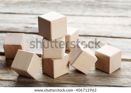 Wooden toy cubes on a grey wooden table - stock photo