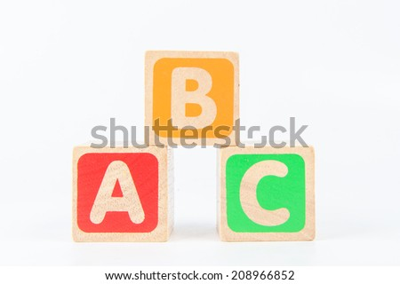 wooden toy cubes with letters. Wooden alphabet blocks - stock photo