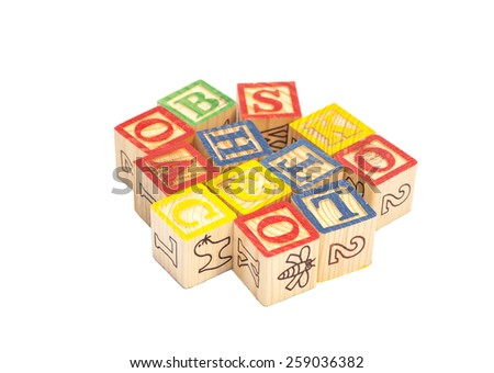 Wooden toy cubes with letters. Wooden alphabet blocks