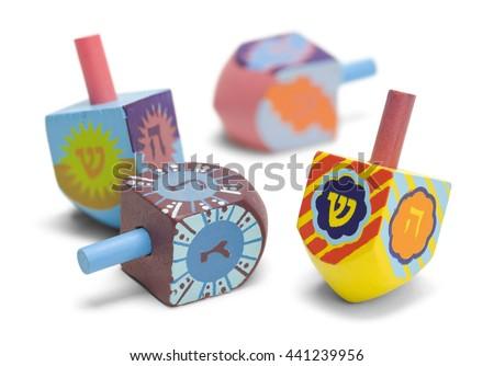 Wooden Toy Jewish Dreidels Isolated on White Background. - stock photo