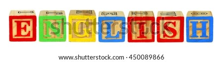 Wooden toy letter blocks spelling ENGLISH isolated on white