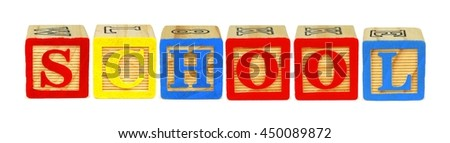 Wooden toy letter blocks spelling SCHOOL isolated on white