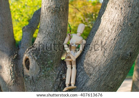 Wooden toy man in spring