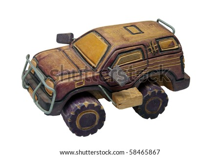 Wooden toy replica model of a four-wheel drive (4 x 4) sports utility vehicle (SUV) - stock photo