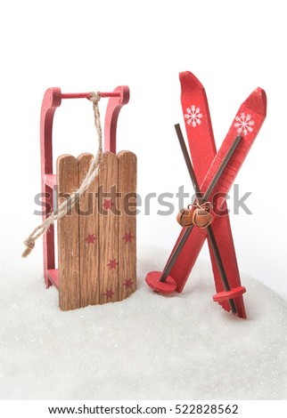 Wooden toy sled with skis in sugar