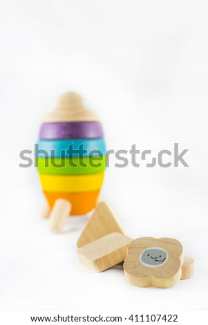 Wooden toy spacecraft isolated on white background - stock photo
