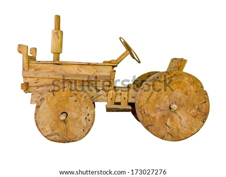 Wooden toy tractor Hand made on white isolated background - stock photo