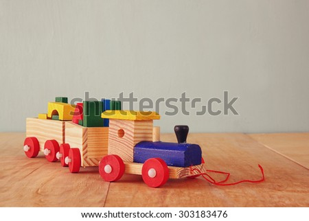 Wooden toy train over wooden floor. selective focus.