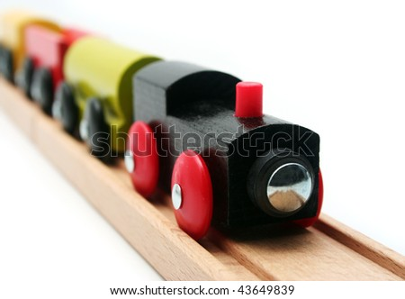 Wooden Toy Train Set on White Background - stock photo