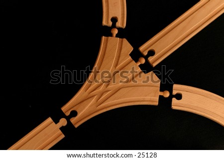 Wooden toy train track in pieces. - stock photo