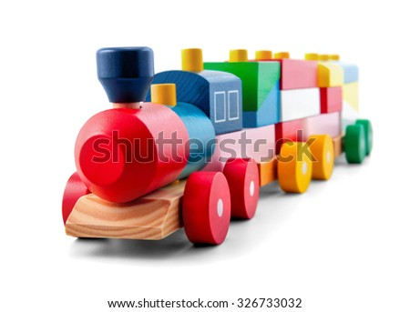 Wooden toy train with colorful blocks isolated over white - stock photo