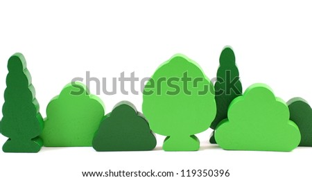 Wooden toy trees isolated on white background - stock photo