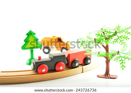 Wooden toys for children on a white background - stock photo