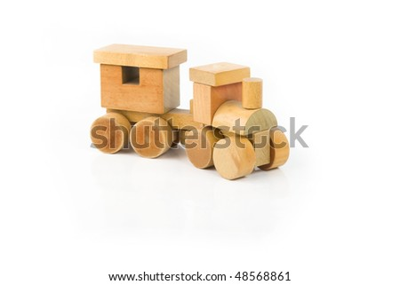 Wooden train on a white background - stock photo