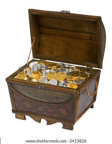 Wooden treasure chest filled with gold & silver chocolate candy coins. - stock photo