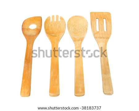 Wooden utensils in a row - stock photo