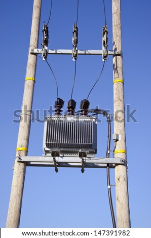 Wooden Utility Pole with Power Lines and transformer on sky background - stock photo