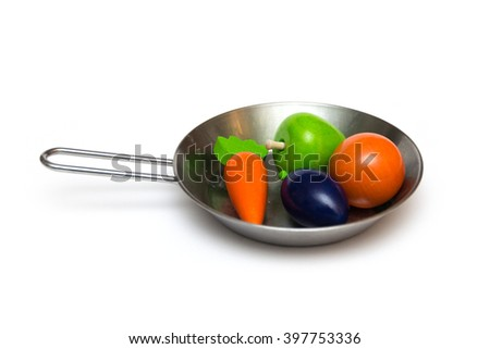 wooden vegetables in a pan for children isolated on white background - stock photo