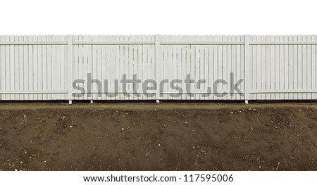Wooden village fence painted gray. The fence is on fresh ground without grass . Isolated fragment