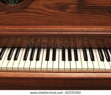 wooden vintage piano - stock photo