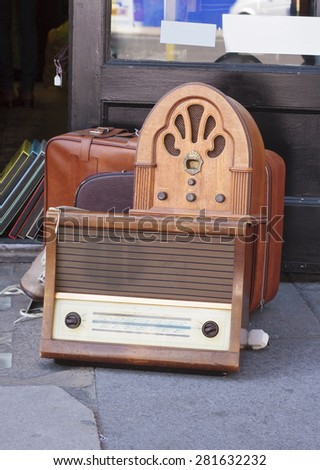 Wooden vintage radios outside a secondhand shop - stock photo