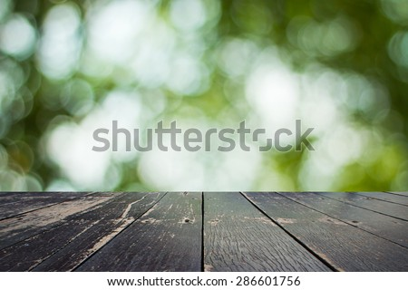 Wooden walkway and bokeh background - stock photo