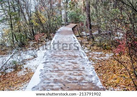 wooden walkway in winter at Pudacuo(Potatso) national park  in the Shangri-La(Zhongdian), Yunnan, China. - stock photo