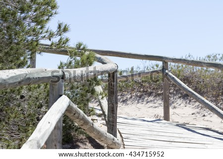 Wooden walkway over dunes. Photo taken in Pinet beach, Elche, Spain