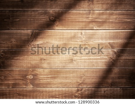 Wooden wall background in a evening light. With shadows from a window frame. - stock photo