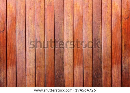 Wooden wall background made with vertical planks of hardwood
