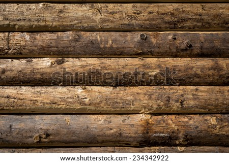 Wooden wall from logs as a background texture - stock photo