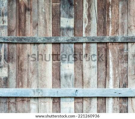 Wooden wall of old hut in the rural of Thailand. - stock photo