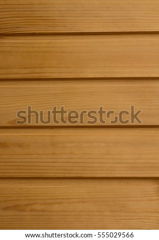 Wooden wall of planks vertically raspolezhennyh light beige color as the texture of a wooden surface
