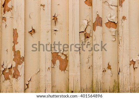Wooden wall with areas falling paint - stock photo