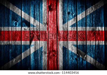 wooden wall with British flag - stock photo