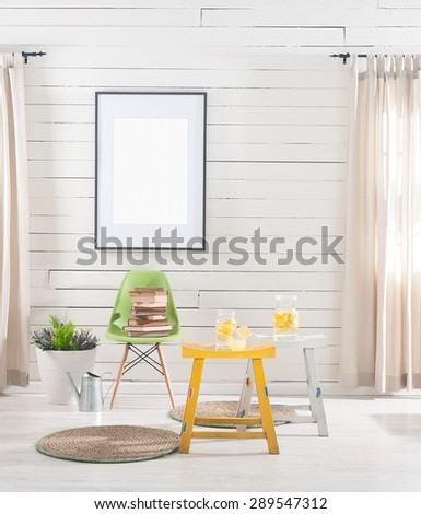wooden wall  with green chair - stock photo