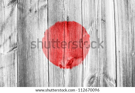wooden wall with japan flag - stock photo
