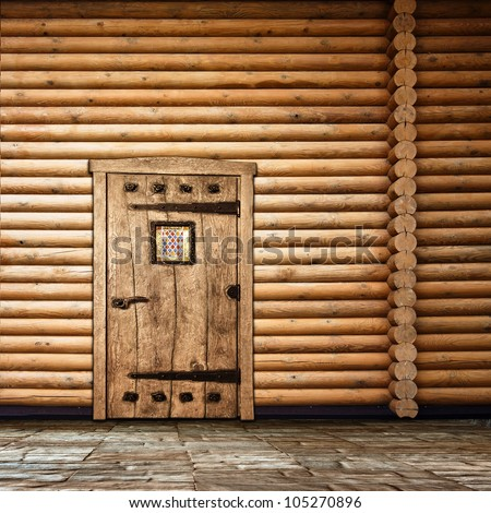Wooden wall with old door - stock photo