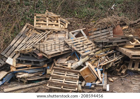 Wooden waste dumped beside a road - stock photo