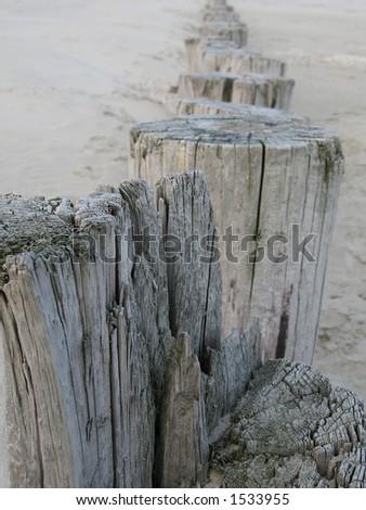 Wooden wavebreaker - stock photo