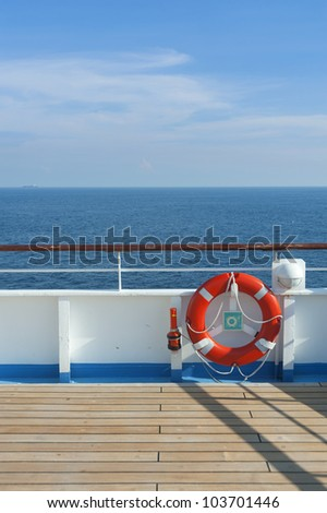 Wooden wharf,buoy and blue Sky on Cruise Ship - stock photo