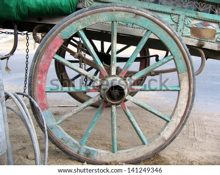 wooden wheel for loader transport - stock photo