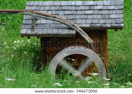 Wooden wheel of an ancient water mill in Austria