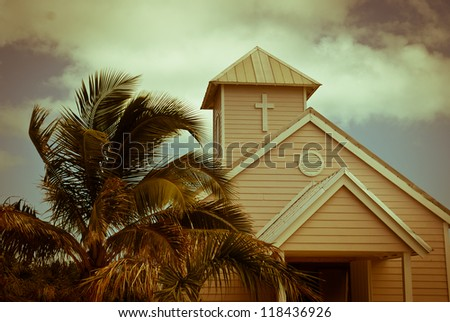 Wooden white church and palm trees, Bahamas - stock photo