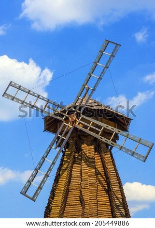 wooden windmill against the sky - stock photo