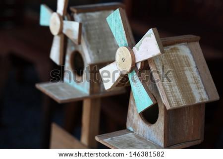 wooden windmill bird house. - stock photo