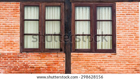 wooden window on a brick wall building - stock photo